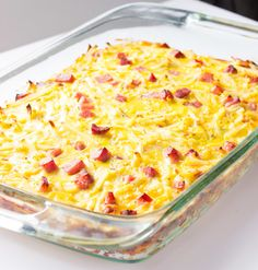 Easy Breakfast Casserole-Used bacon instead of ham, added onion, used refrigerated potatoes (20oz bag) and halved the rest.