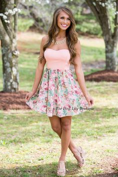 Our bestselling Legendary Love dresses are simply fabulous! Featuring a cute floral print in mint, pink, and tan on the skirt, it looks so feminine and elegant! This strapless dress also has a pink sweetheart neckline made of a super soft material that will keep you comfortable all day long! Pair it with a statement necklace and wedges to complete this sweet look!