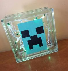 Minecraft party Creeper but green **Cover the entire face with the creeper print-out, put a string of green lights in, for a night light