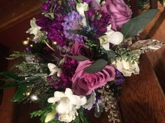 Willows by Wehr winter bridal bouquet of shades of purples lavander and creams . Succulents roses, freesia, roses, scabiosa and statice ...  @thewillowsbywehr.com Columbiana Ohio  330.482.2223