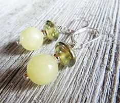 Calcite art glass earrings yellow stone and shimmering discs by Gwynstone Purple Flower Photos, Boho Jewelry, Unique Jewelry, Dolphin Jewelry, Moonstone Earrings, Gifts For Nature Lovers, Yellow Earrings, Glass Earrings, Gift For Lover