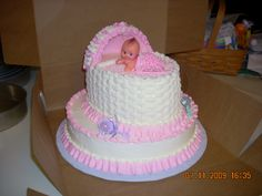 Baby Shower cake I made.  My signature bassinet with a sugar molded canopy and a little fondant blanket covering the baby.