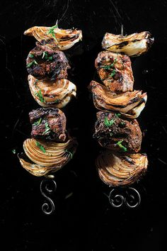 Robust lamb and onion kebabs steeped in a tenderizing seltzer and vinegar marinade are paired with a sauce of tomatoes, prunes, and herbs.