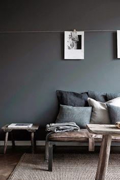 This dark grey has been softened by the warm textures of linen and weathered wood.