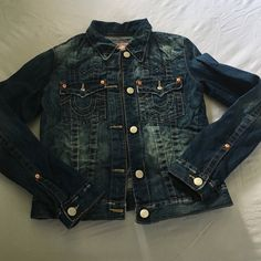 True Religion denim jacket EXCELLENT Condition true religion denim jacket. Distressed look. Looks like the day that I bought it, like brand new! Size large but fits more like a medium/ large. Medium would be comfortable and maybe a large for someone that doesn't have as big a chest as mine. I'm a 36DD and its snug on me. No lowball offers please! I REALLY hate to let this beauty go. True Religion Jackets & Coats Jean Jackets