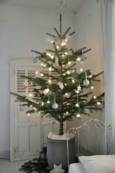This is a clever idea for my son's first Christmas. It looks nice without tempting him to pull the low branches.