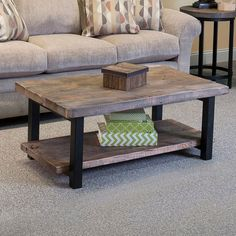 Featuring a 2-tiered metal and wood design, this understated coffee table adds a rustic touch to your living room or parlor.