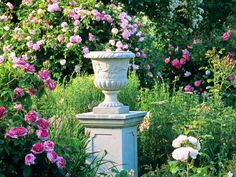 Stone garden urns instantly create a timeless look in any garden, but especially in this lovely rose garden. Originals can be found at salvage yards, but composite stone or cast concrete options are more widely available and much more affordable.