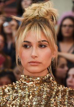 Hailey Baldwin with a loose bun and fringe | ASOS Fashion & Beauty Feed