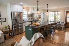 To help define the kitchen area, we added this large island and painted it a pretty soft green color.