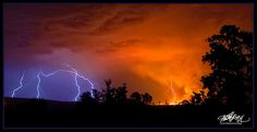 Fire and Ice. An early Spring lightning storm starts a grass fire and is captured here with strikes falling around and into the fire. Minutes later the storm extinguishes the fire it started and the moment is gone. From Mitchell Krog's Fire and Ice Lightning Photography Series