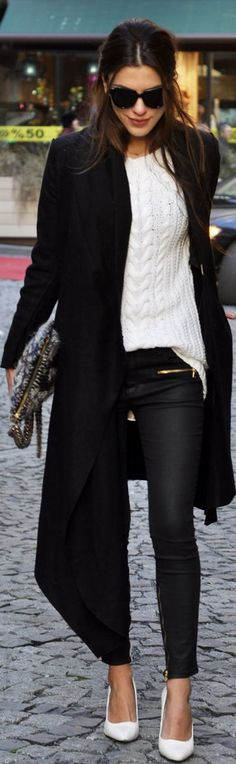 Cold-weather chic: knit sweater, gold lined zippered pants and an over-sized clutch.