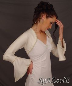 This is the style of the bolero jacket that my bridesmaids will wear with the Arabelle gown for the Church ceremony. It will be custom made to your measurements using ivory silk  covered with silk chiffon to match the gown exactly.