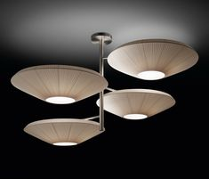 SIAM breaths a certain oriental air derived from the inverted shade. It takes its essence from MEI and offers a soft cascading light. These luminaires can be grouped in varying compositions, superposing shades partially one over the other, and creating a perfect mural for any space.