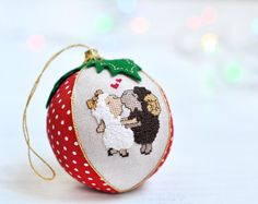 Adorable first Christmas together ornament! A gorgeous keepsake for your first Christmas! This bauble is from my series of personalized Christmas ornaments - unique, safe and memorable. ✄✄✄✄✄✄✄✄✄✄✄✄✄✄✄✄✄✄✄✄✄✄✄✄  This couple Christmas ornament is sewed from the highest quality cotton and linen fabrics with a soft filler inside. One sector is decorated with the miniature hand embroidered kissing sheep in love :) Another sector can be personalized with your names and special date (or any other…