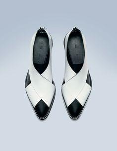 White/black leather flat