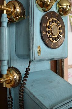 paintmeshabbychic's blue clock.  Love it and think I just may paint ours like this.