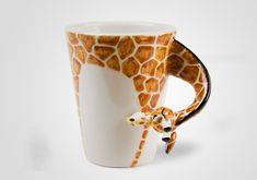 Caneca com alça de animal (http://www.centralcrafts.com/giraffe/8oz-orange-ceramic-coffee-mug.html)
