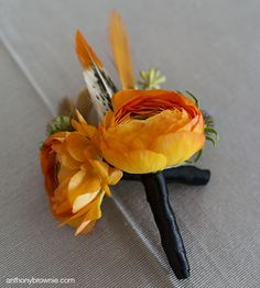 Fiery #boutonniere with #feathers