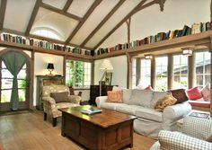 books all around the ceiling - I've thought about doing this on at least one wall in my living room...