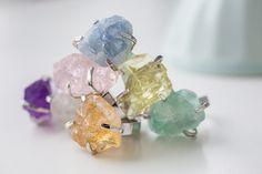 A rainbow of raw gemstones.
