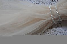 ivory Grenadine Lace Fabrics Gauze Mesh Fabric Wedding Gown Fabrics Supplies Costume Supplies  ======MATERIAL======  mesh fabric  =====MESUREMENT=====  <Size> width: 150cm One yard of this fabric measures about 59''--35.82 =======COLOR======== ivory as seen in the picture, we also have blue, lavender, white, pink available.    ======QUANTITY======  This listing is for one yard, cono me if you need more, we will supply with uncut piece   ======FEATURES======  * Designed by famous master…