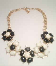This is the cutuest necklace! Purchase your Black and White Flower Necklace at ww.thejewelledbee.com for ONLY $22!