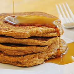An easy and healthy way to indulge in those pumpkin cravings, whole wheat pumpkin pancakes.