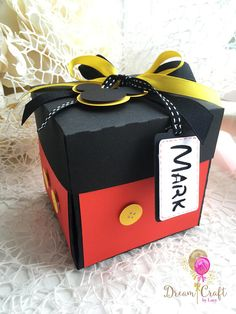 Mickey and Minnie Mouse Explosion box! This handmade photo box can be the perfect way to keep your memories from your journey to Disneyland or any other occasion. Its a great idea to surprise someone and pop the message We are going to Disneyland or Happy Birthday!. This box uses