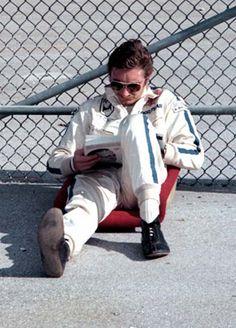 Race driver Jo Siffert reads at Daytona, 1970