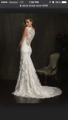 Don't have a picture of me showing the backside, but here's a pic from the website. Loveeee the back of my dress!