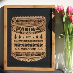 This laser cut, personalized birth certificate is modern and cool.