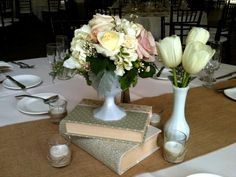 Beautiful vintage wedding centerpiece with books and milk glass by Soleil Flowers, Temecula CA