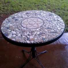 Idea for mosaic patio table - I am needing one of these! I like the brown and the random shapes, but it would look best with at least some blue (center?) to put out by the pool. (Inspiration only, searched images)