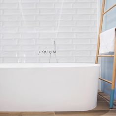 Aria white metro are new in and offer beautiful stylish tiles at a great price. These gloss white tiles look stunning on their own or maybe try a simple chrome trim. White Brick Tiles, White Wall Tiles, Bathroom Fireplace, Bathroom Wall, Tile Warehouse, Tiles Direct, Minimal Kitchen, Metro Tiles, Kitchen Tiles