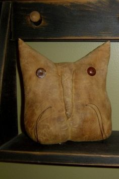Primitive Cat Head Pattern
