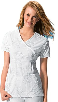 Style Code: (CH-6719MK)   This mock wrap top features neck binding, release tucks at the waist, and patch pockets. Left pocket has pencil stitch, right pocket has stitched down instrument loop, back elastic, and side vents complete this top.