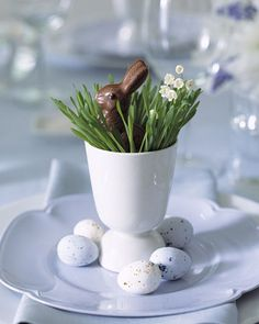 Wheatgrass Setting with Chocolate Bunny Favors    Decorating for a seasonal lunch needn't be elaborate to feel festive. We used vintage eggcups for these place settings, but you could also use teacups. Fill them with wheatgrass (from health-food stores) and lilies-of-the-valley. Add chocolate bunnies and eggs for postmeal nibbling.