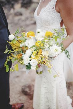 organic and free-flowing white, yellow and green #weddingbouquet. Via @eventsbymint
