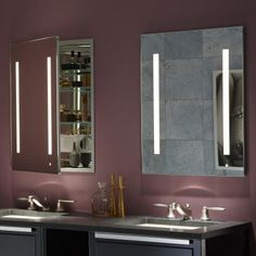 Medicine cabinet mirrors with built in lights and outlets. sweet!