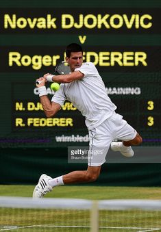 Novak Djokovic of Serbia plays a backhand in the Final Of The Gentlemen's Singles against Roger Federer of Switzerland on day thirteen of the Wimbledon Lawn Tennis Championships at the All England Lawn Tennis and Croquet Club on July 12, 2015 in London, England.