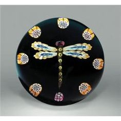 Paul Ysart dragonfly paperweight, composed of a central dragonfly, having yellow, blue, and white...