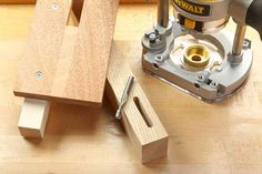 How to cut mortises accurately with a hand-held router, a straight bit, a template guide and a few scraps.