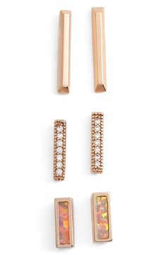 This cool and modern set of earrings adds glittering crystals and luminous coral opal to rose gold bars for a feminine and fun look. Find them at @nordstrom