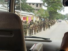 Army on Zanzibar - early morning march towards their barracks.