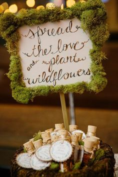 Wildflower seeds wedding favors in vials with cork top. Then it is placed in a basket with moss all around. Gorgeous for a garden or woodland wedding.