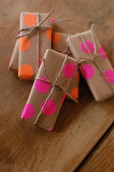 DIY wrapping paper: kraft paper and neon dot stickers. Very cute for the bridal party gifts