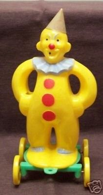 Rosbro Plastic Yellow Clown Candy Container Up for auction is a vintage plastic yellow clown candy container which was made by the Rosen Candy Company (later known as Rosbro). This item was made in t