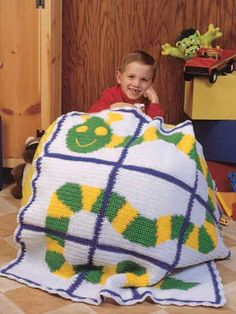 Friendly Critter Afghan - I crocheted this afghan for one of my grandsons in 2014, but I changed up all the colors and added an extra row of squares all around to make it bigger.
