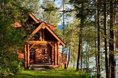 Oh to wake up in a cabin like this with a lake view like that. That would be pure bliss for me.